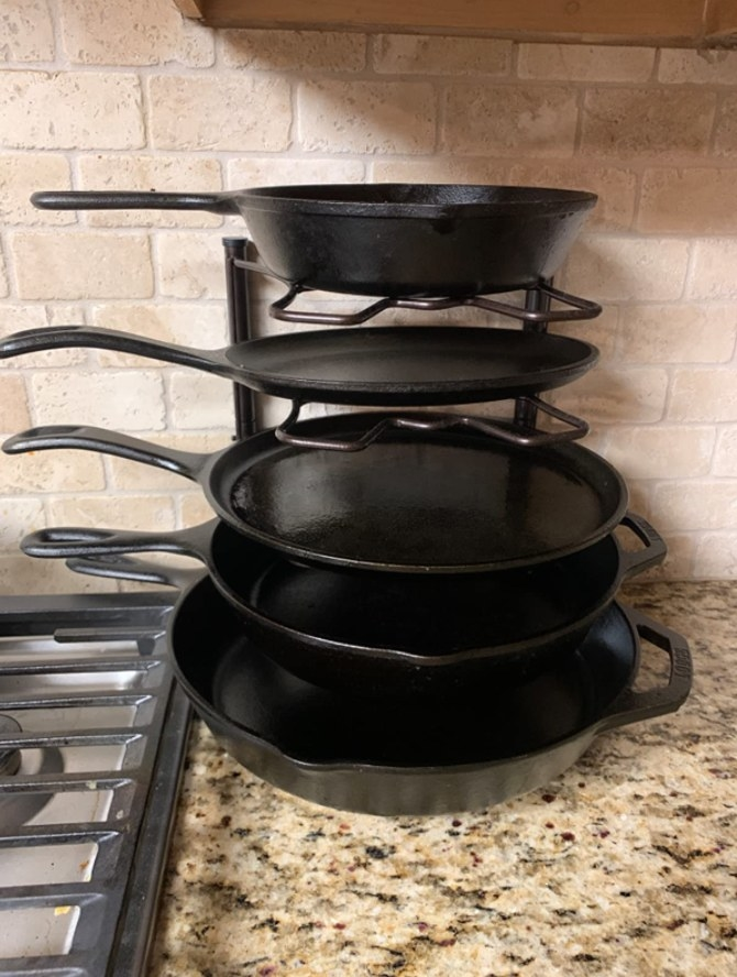 A reviewer's pans stacked up on the rack