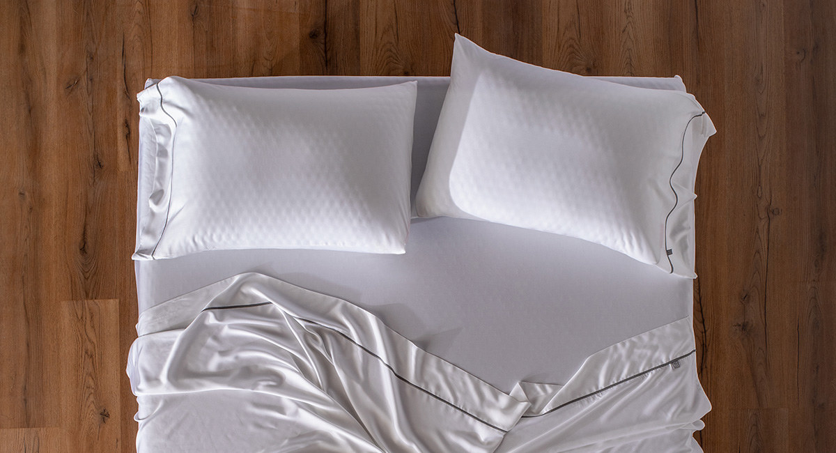 The set of white sheets with grey piping