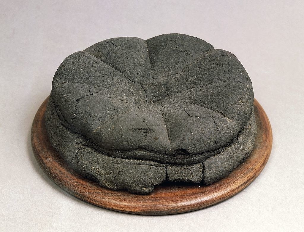 A round loaf of bread that looks to have been turned to stone