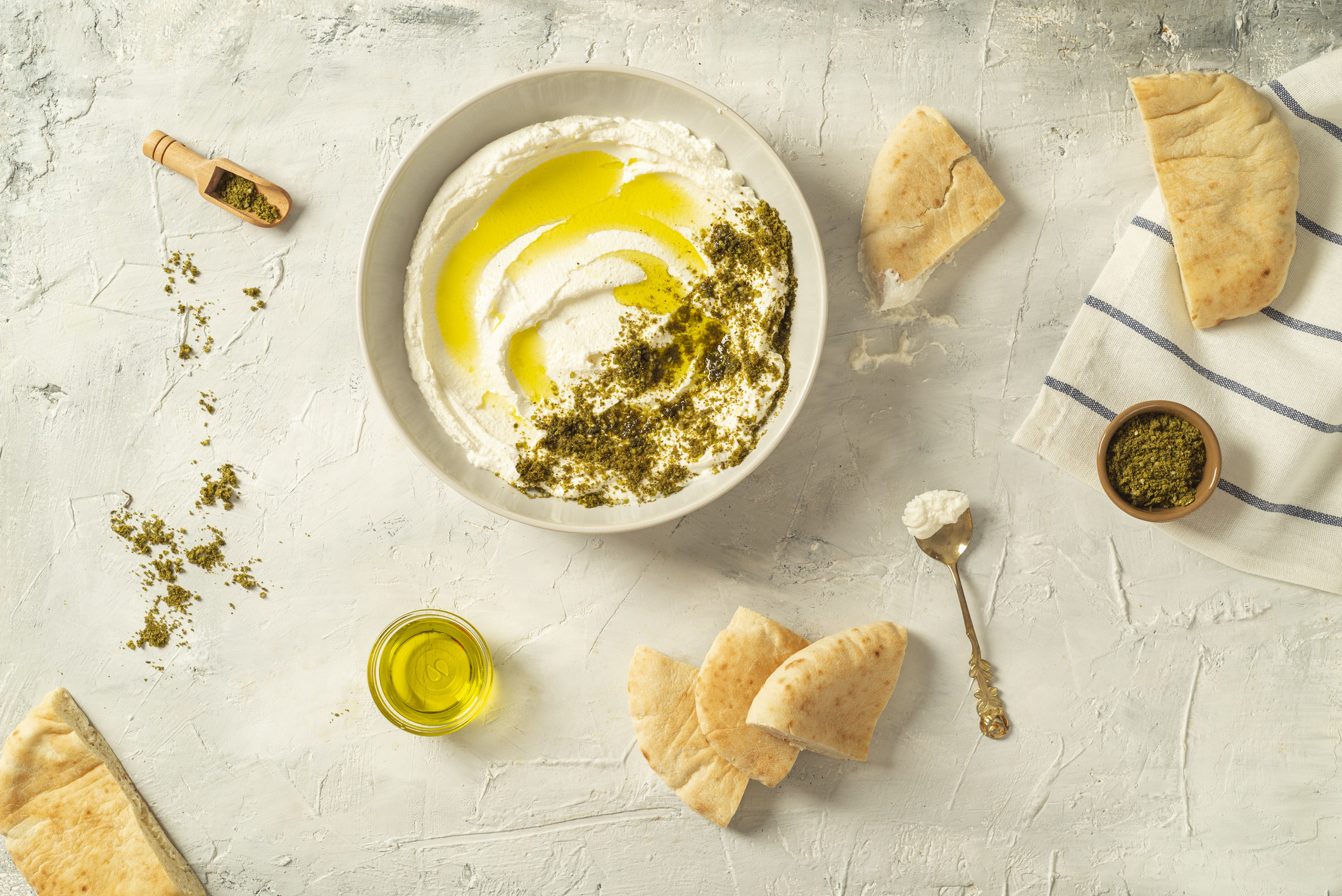 Labne with za'atar and pita bread.=