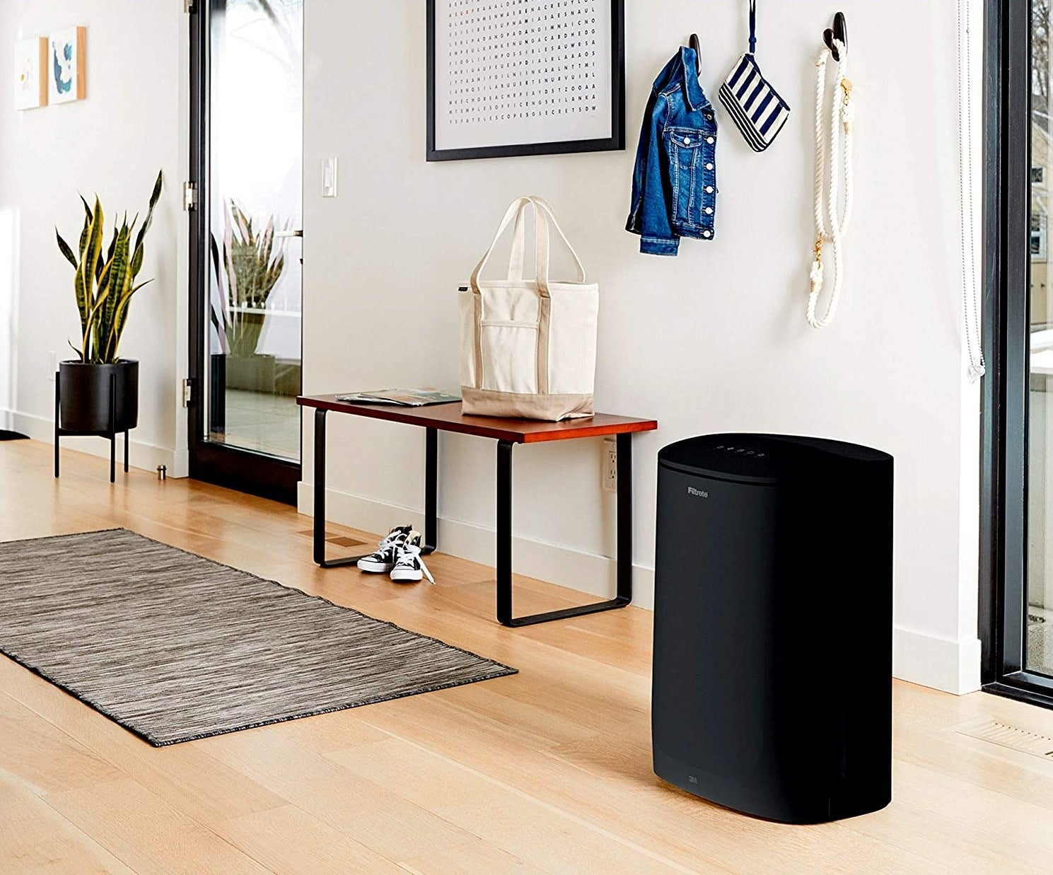 black filtrete air purifier in the entryway of a room