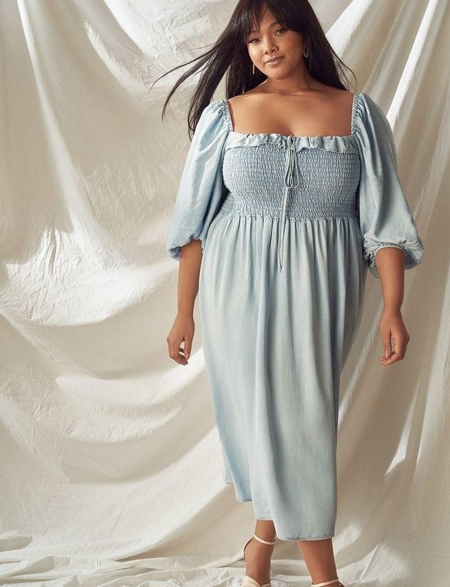 model wearing smocked bodice chabray dress