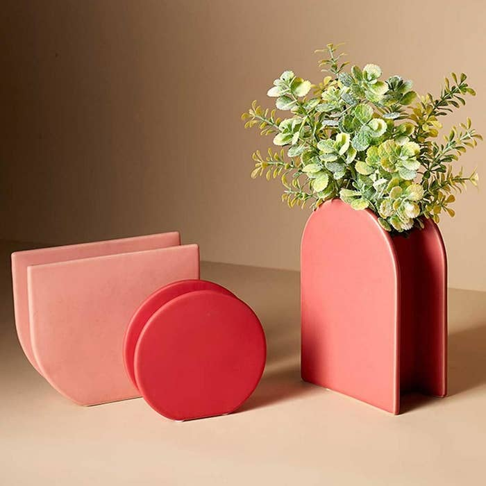 Three ceramic vases of varying shapes and colours
