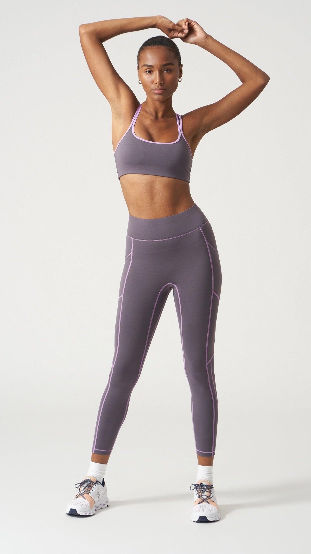 model wearing full-length grey leggings with matching bra