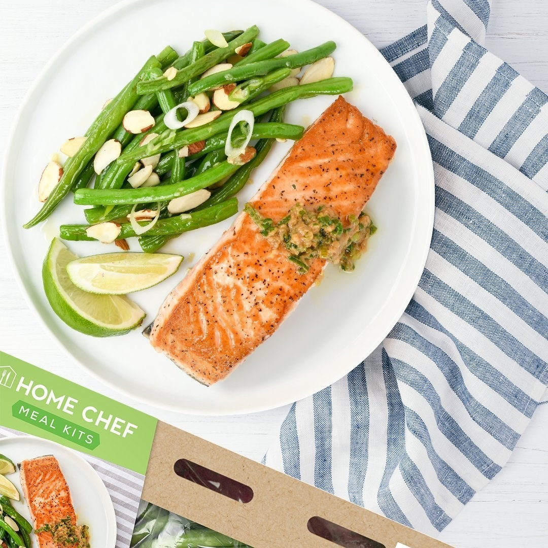 salmon and green beans on a plate with a home chef meal kit box next to it