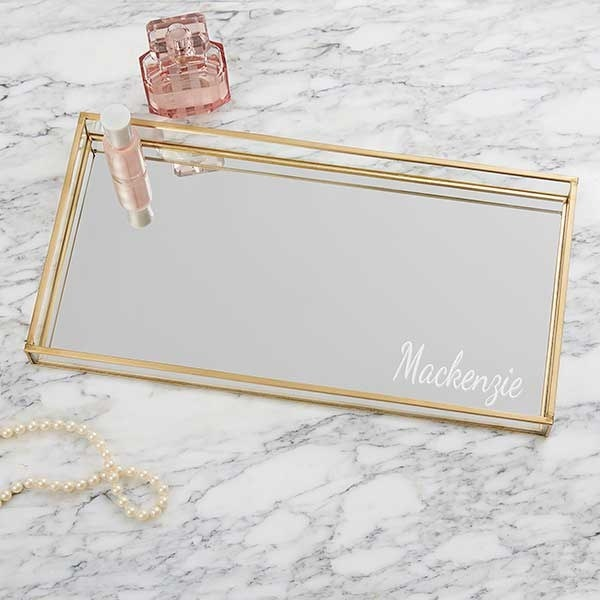 a gold tray with a mirrored base