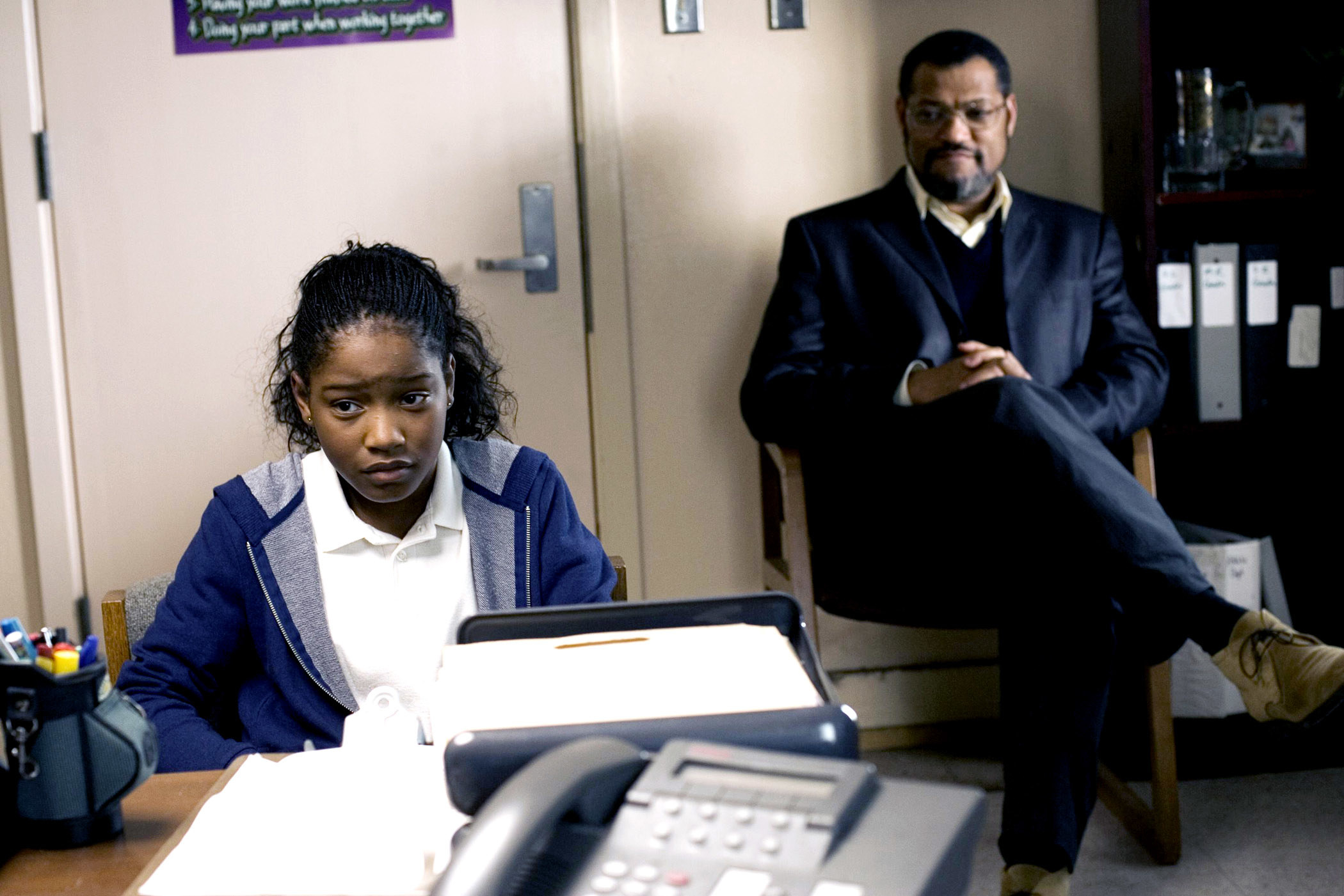 Keke Palmer and Laurence Fishburne sit in an office