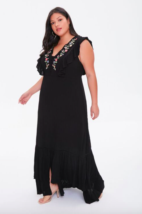 A model wearing the embroidered maxi dress