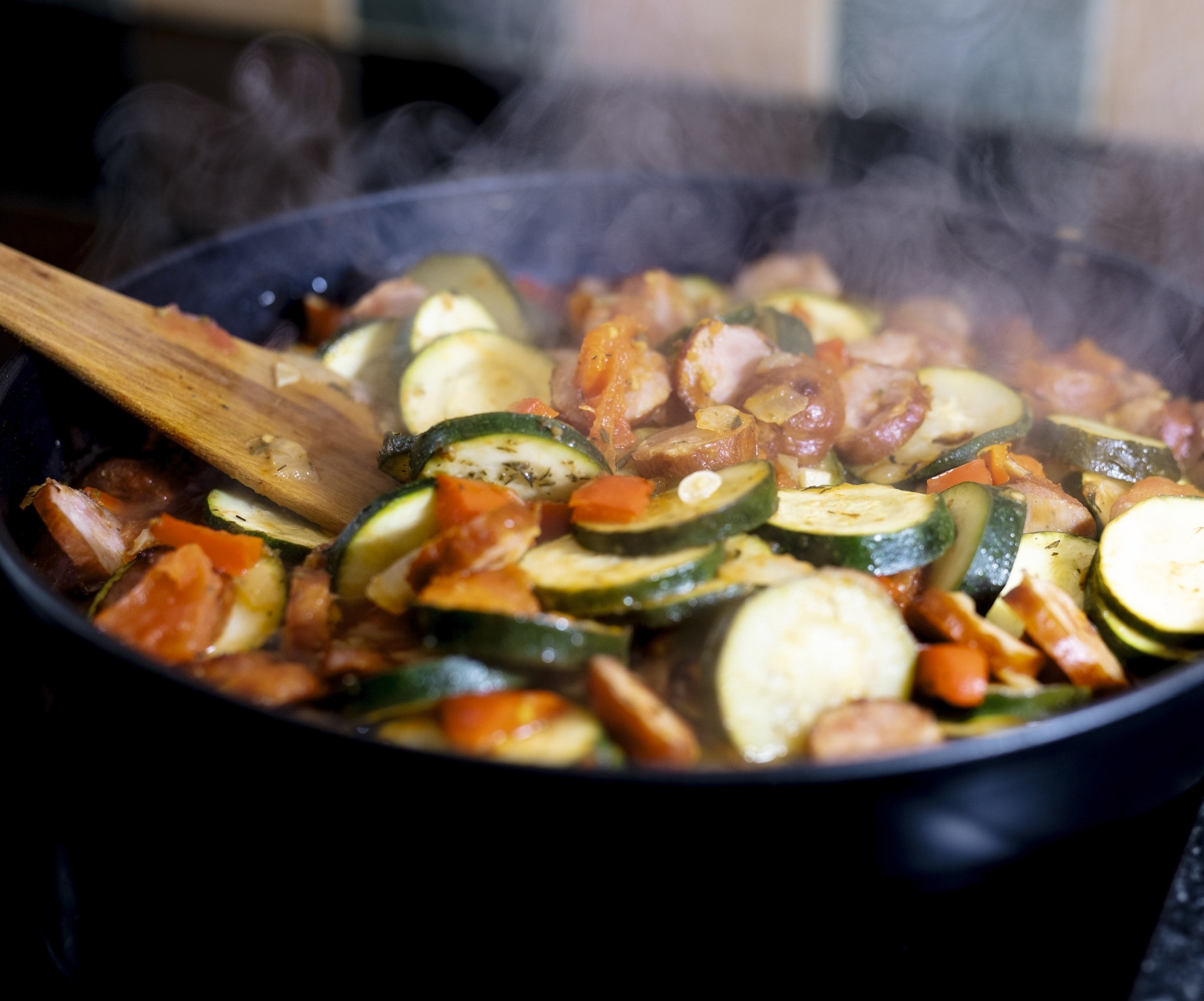 Sautéing sausage and vegetables with paprika