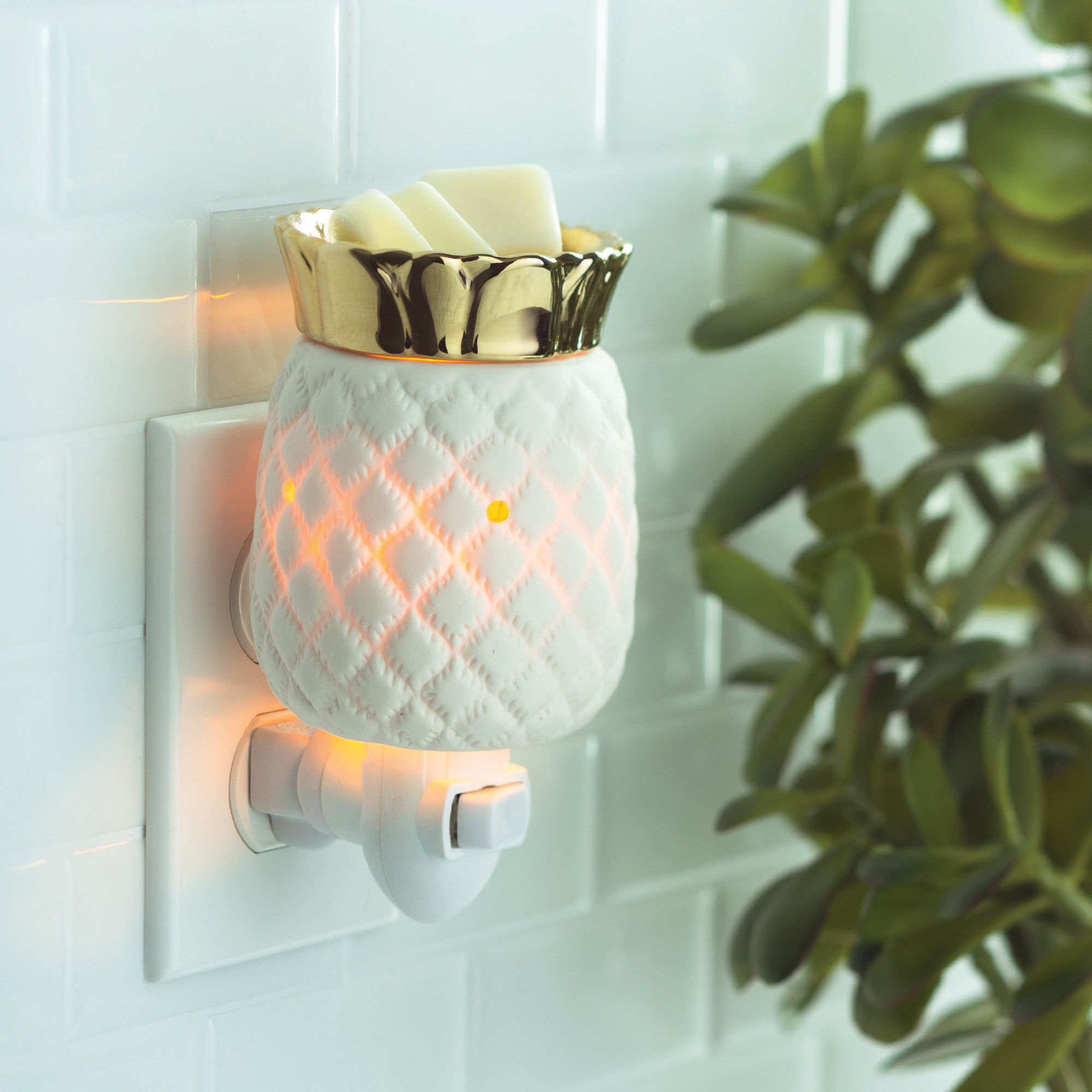 the pineapple warmer with wax plugged into the wall