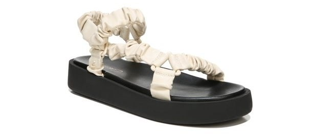 the black sandals with ivory straps