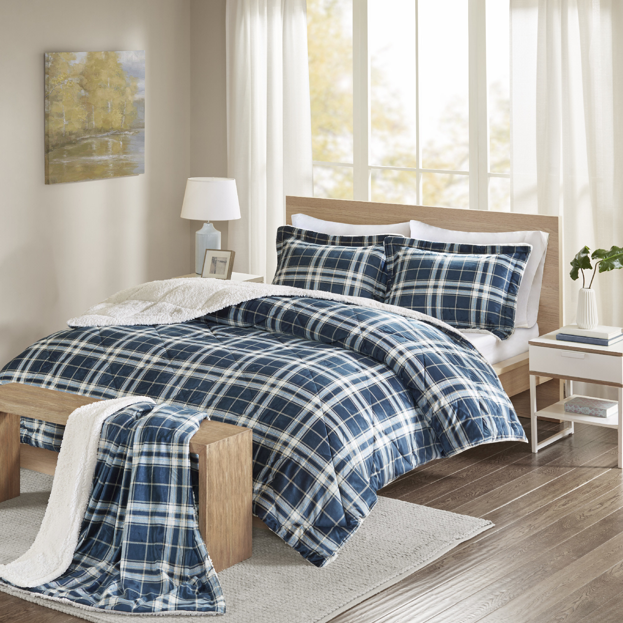 the blue plaid comforter set on a bed
