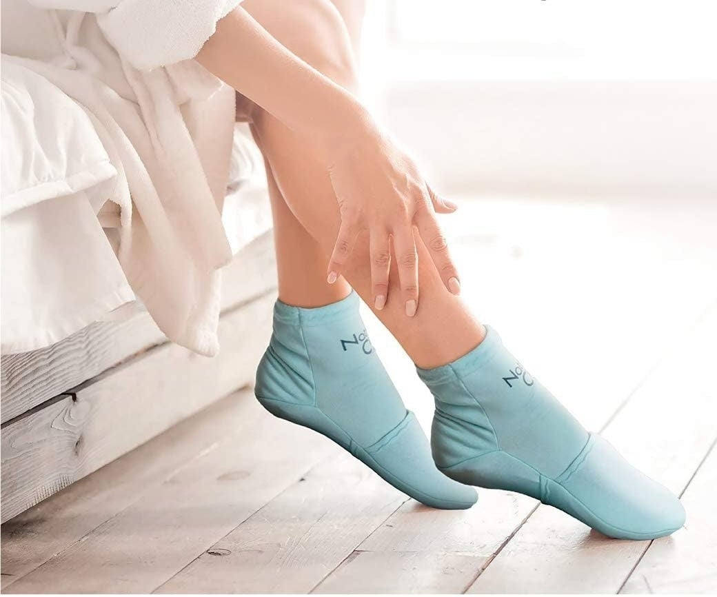 A person wearing the ice pack socks