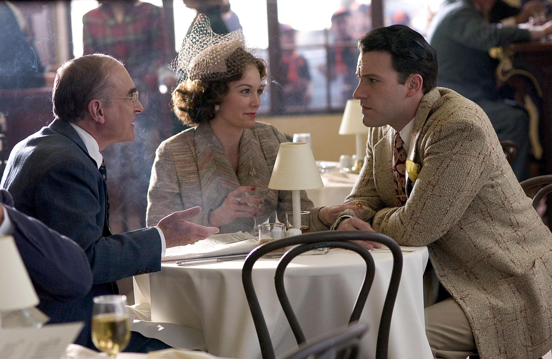 Jeffery DeMunn, Diane Lane, and Ben Affleck sitting around a kitchen table
