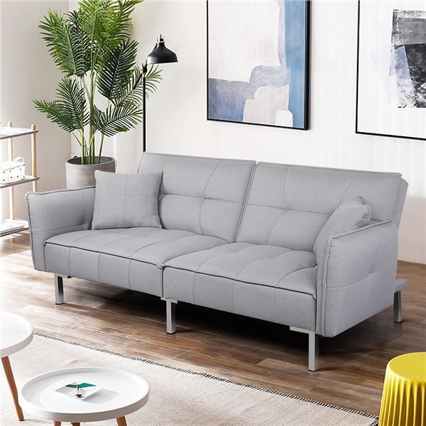 the gray sofa bed in a living room set up