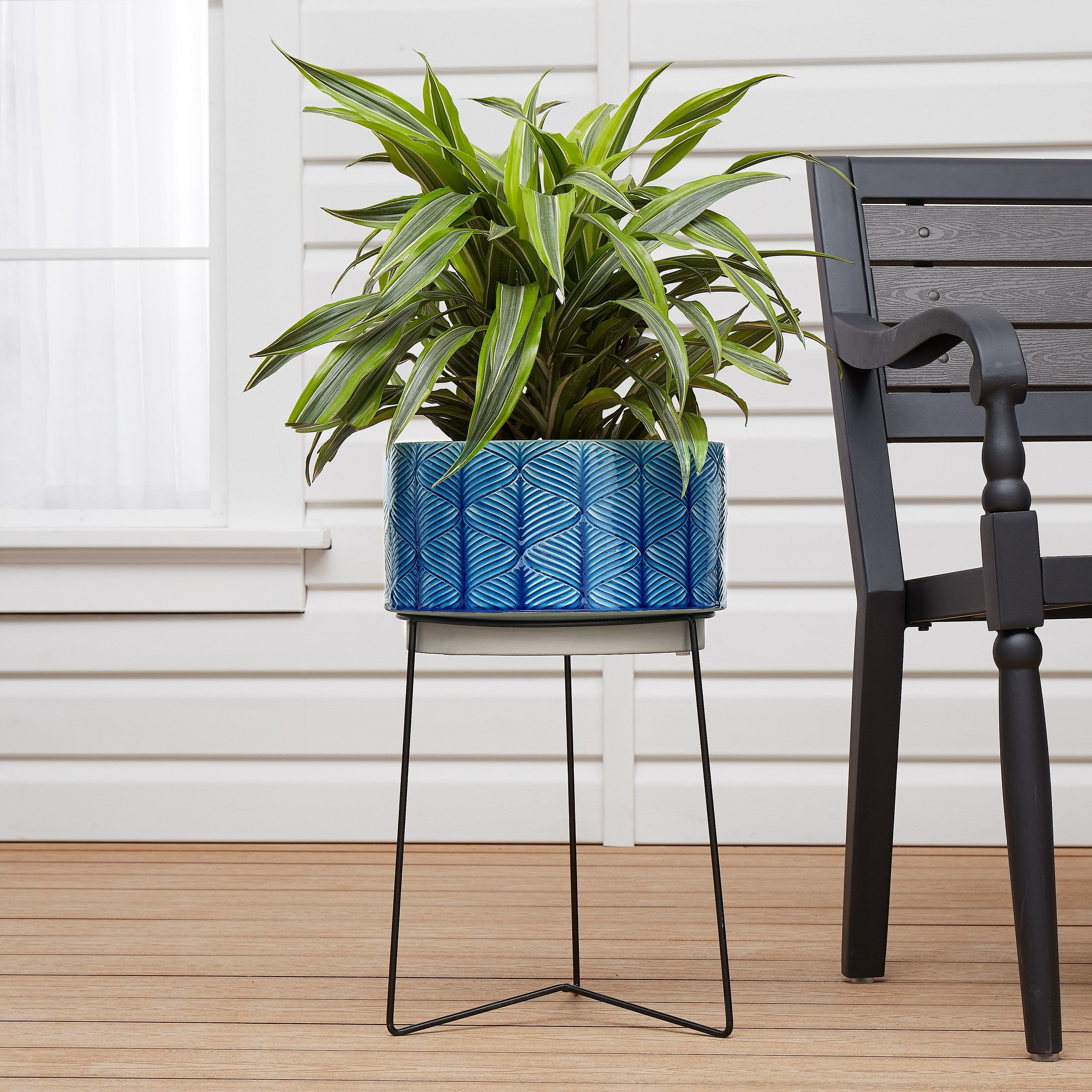 blue textured plant pot on metal stand
