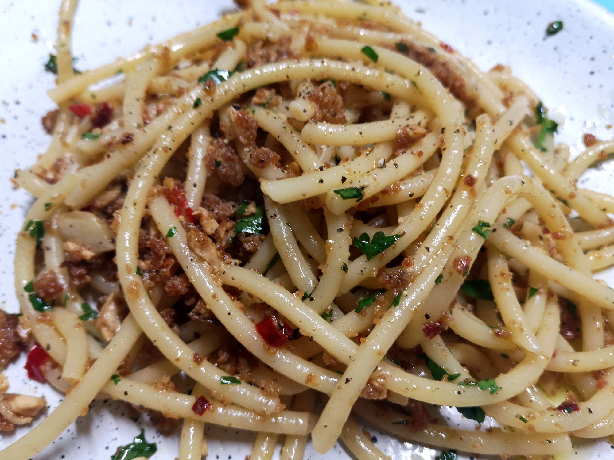 A plate of bucatini with anchovies