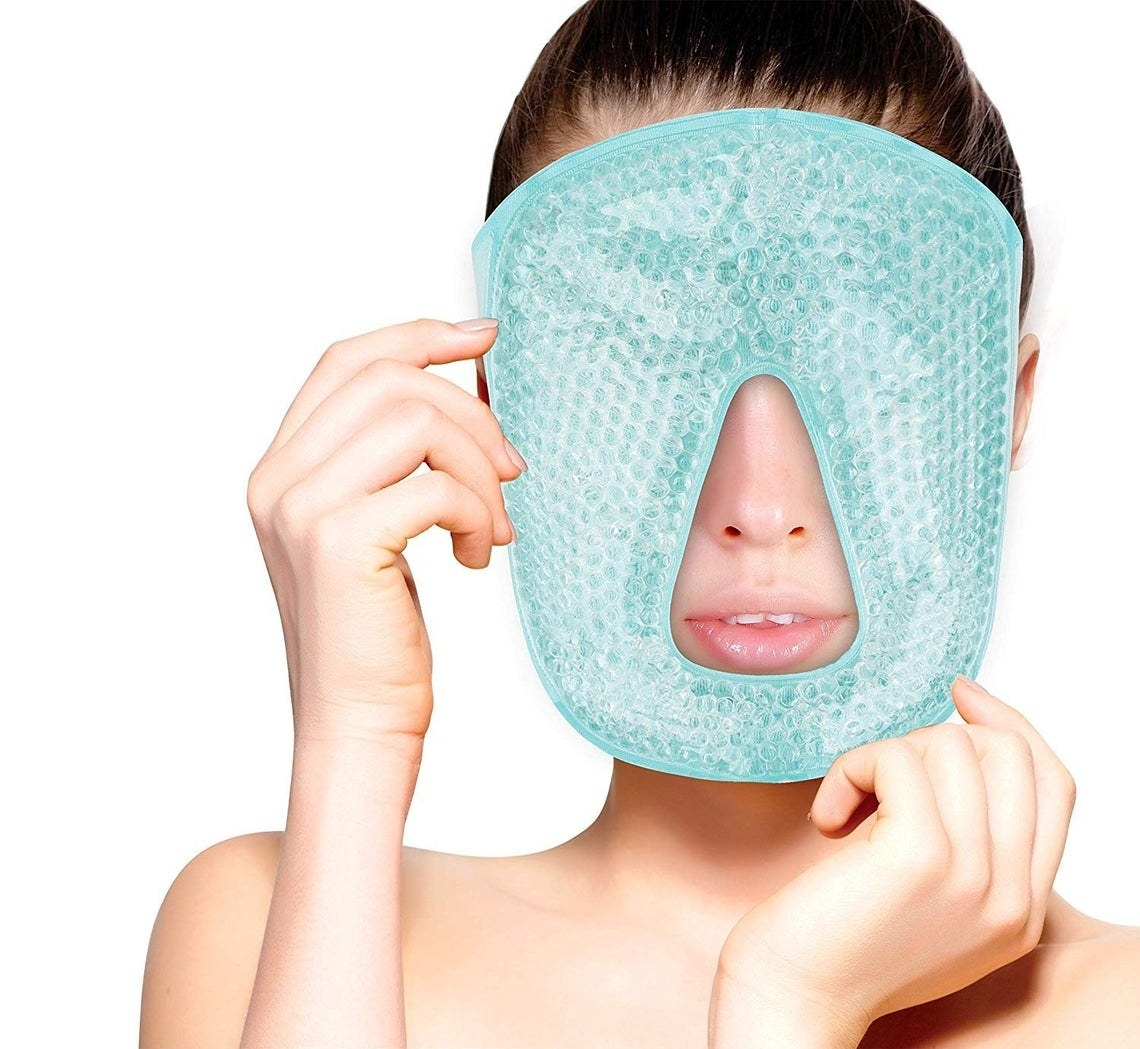 A model holding up the full facial mask to her face