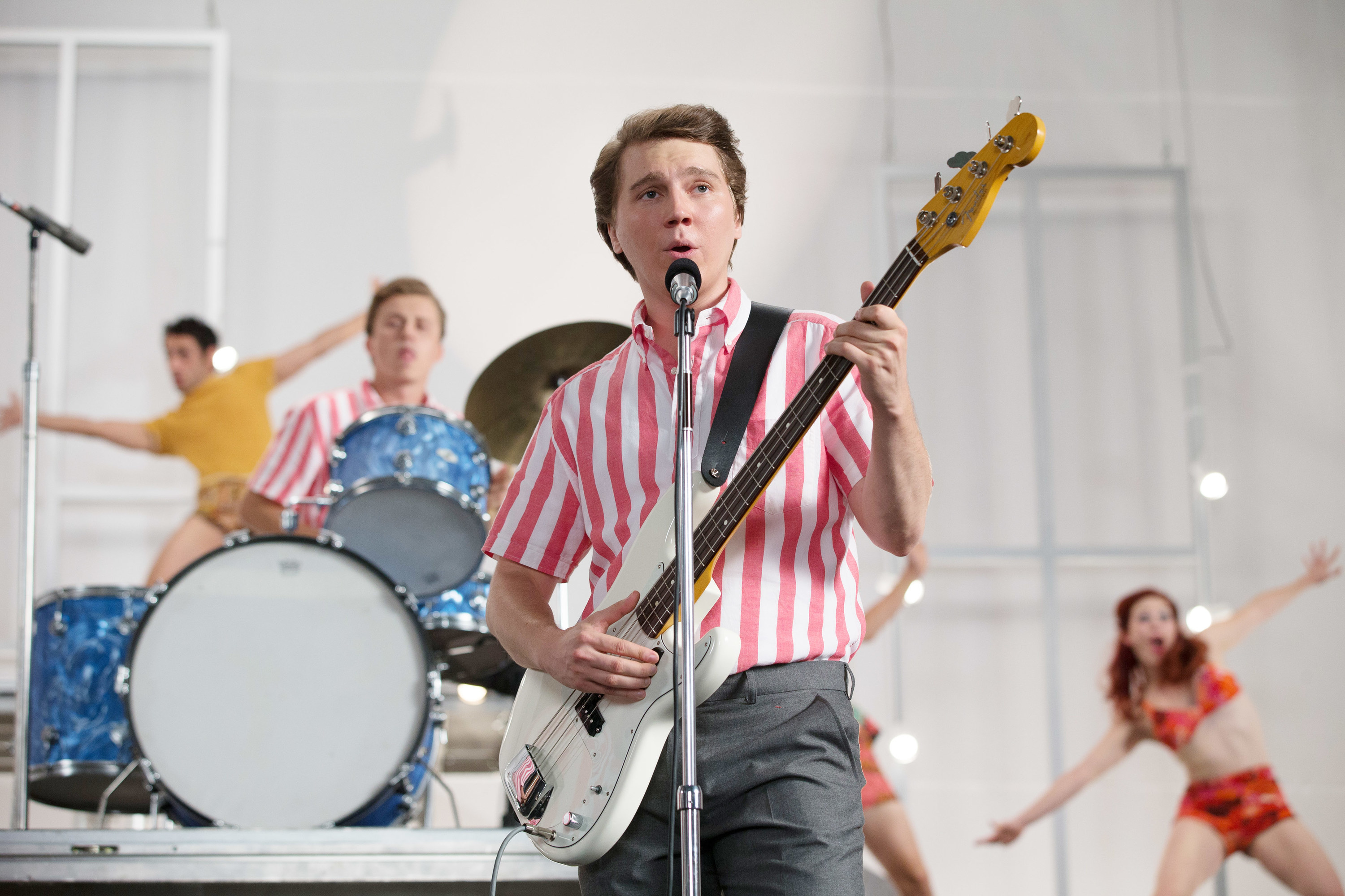 Paul Dano, as Brian Wilson playing bass and  Kenny Wormald as Dennis Wilson playing drums