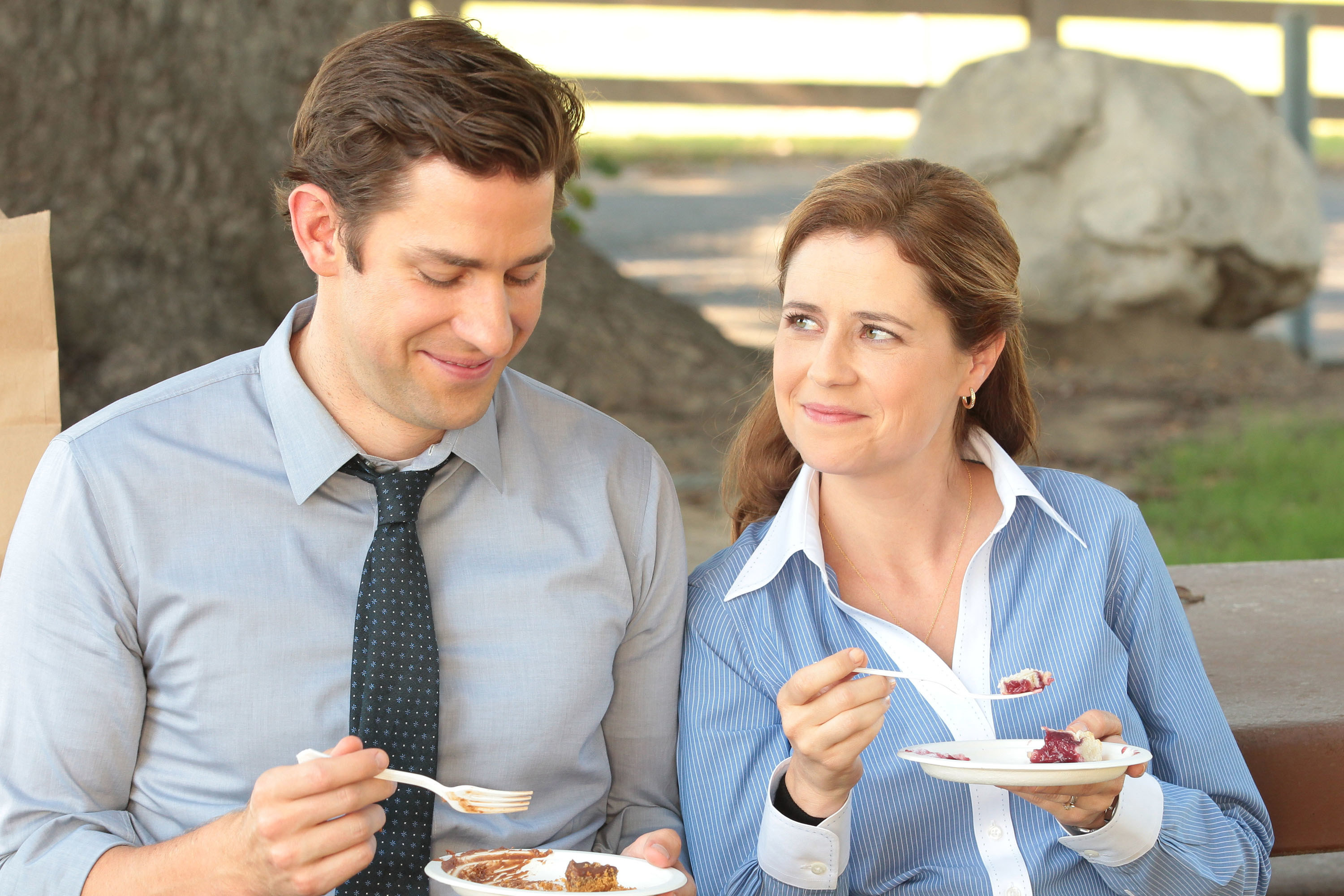 Pam smiles at Jim while they sit outside