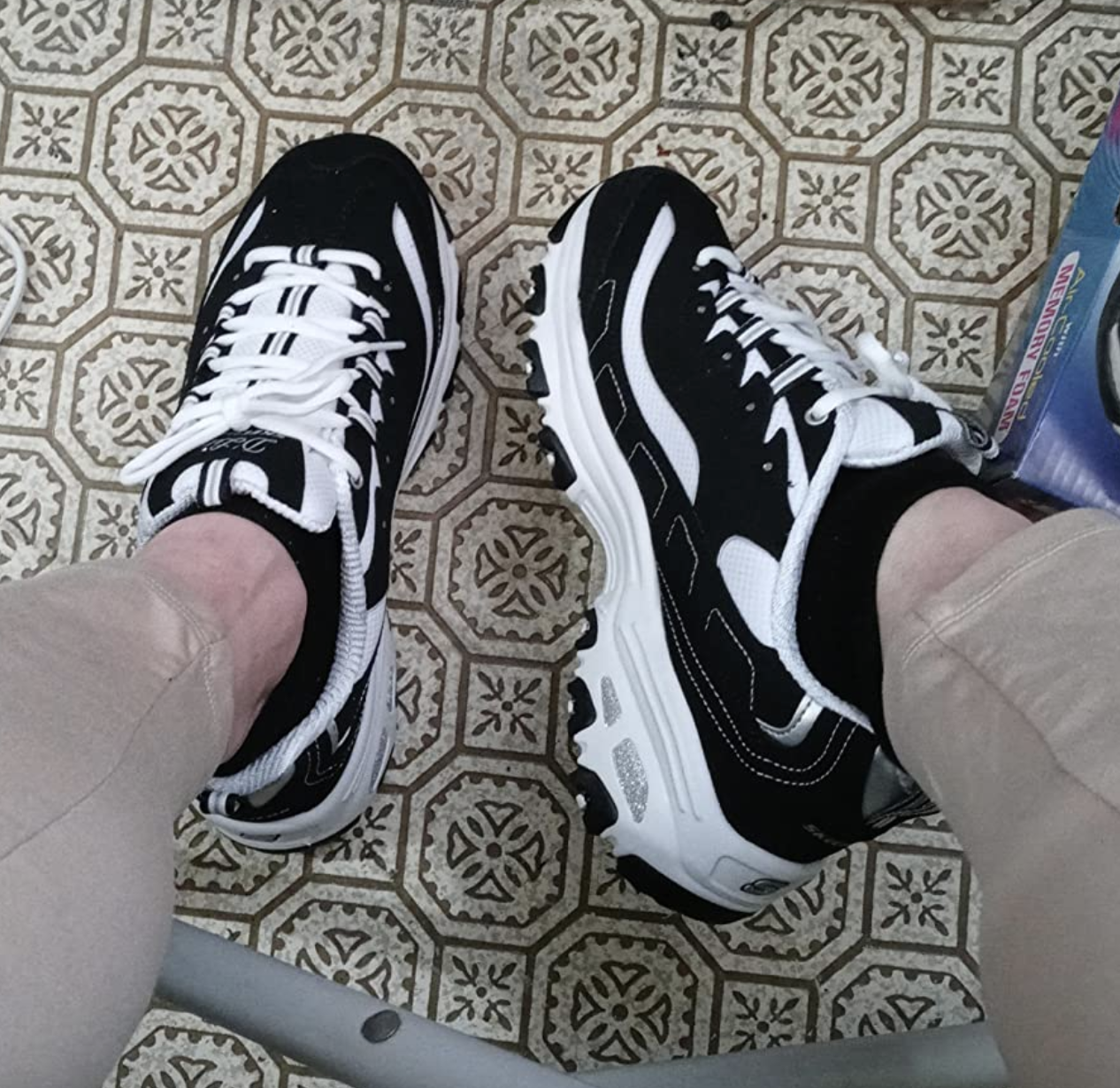 reviewer wearing the sneakers