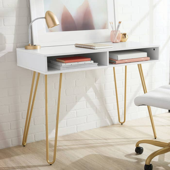 white desk with gold hairpin legs