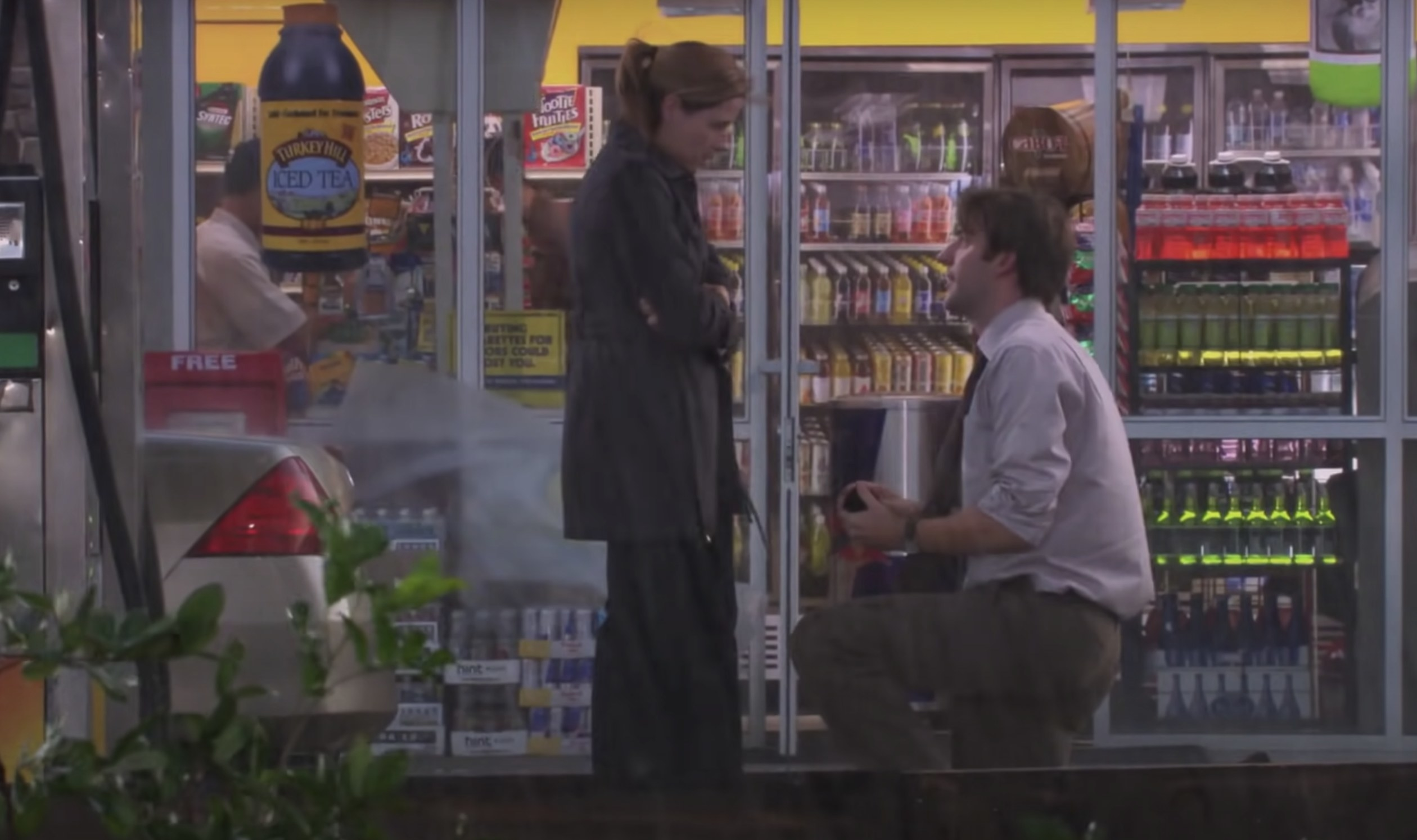Jim gets down on one knee outside the gas station
