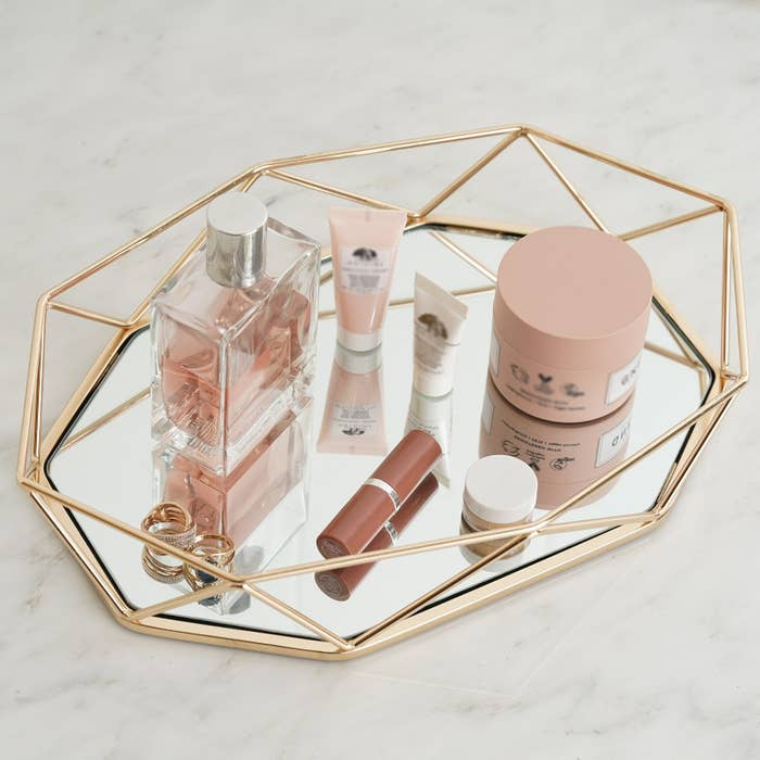 glass and gold mirror tray with geometric design