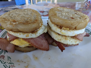 Reviewer image of perfectly round eggs in breakfast sandwiches