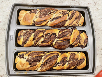 Reviewer image of pan with babka cooked inside