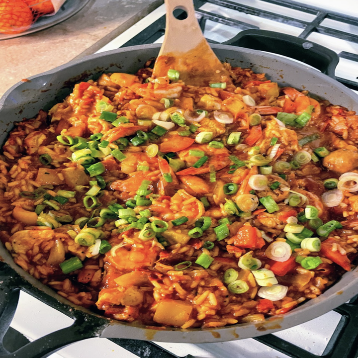 A pan full of a rice and veggie dish