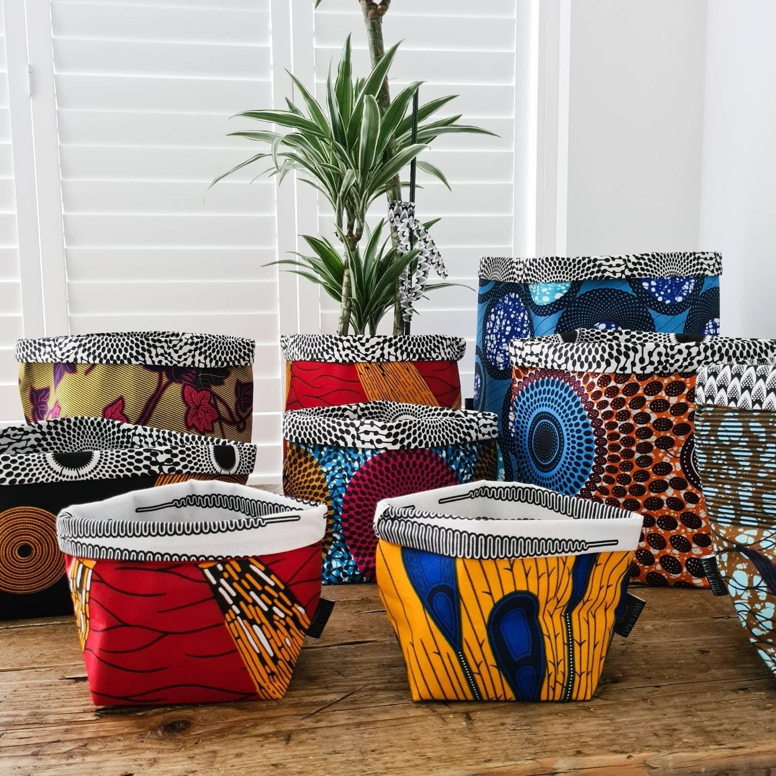 selection of fabric baskets in brightly colored patterns with folded over tops
