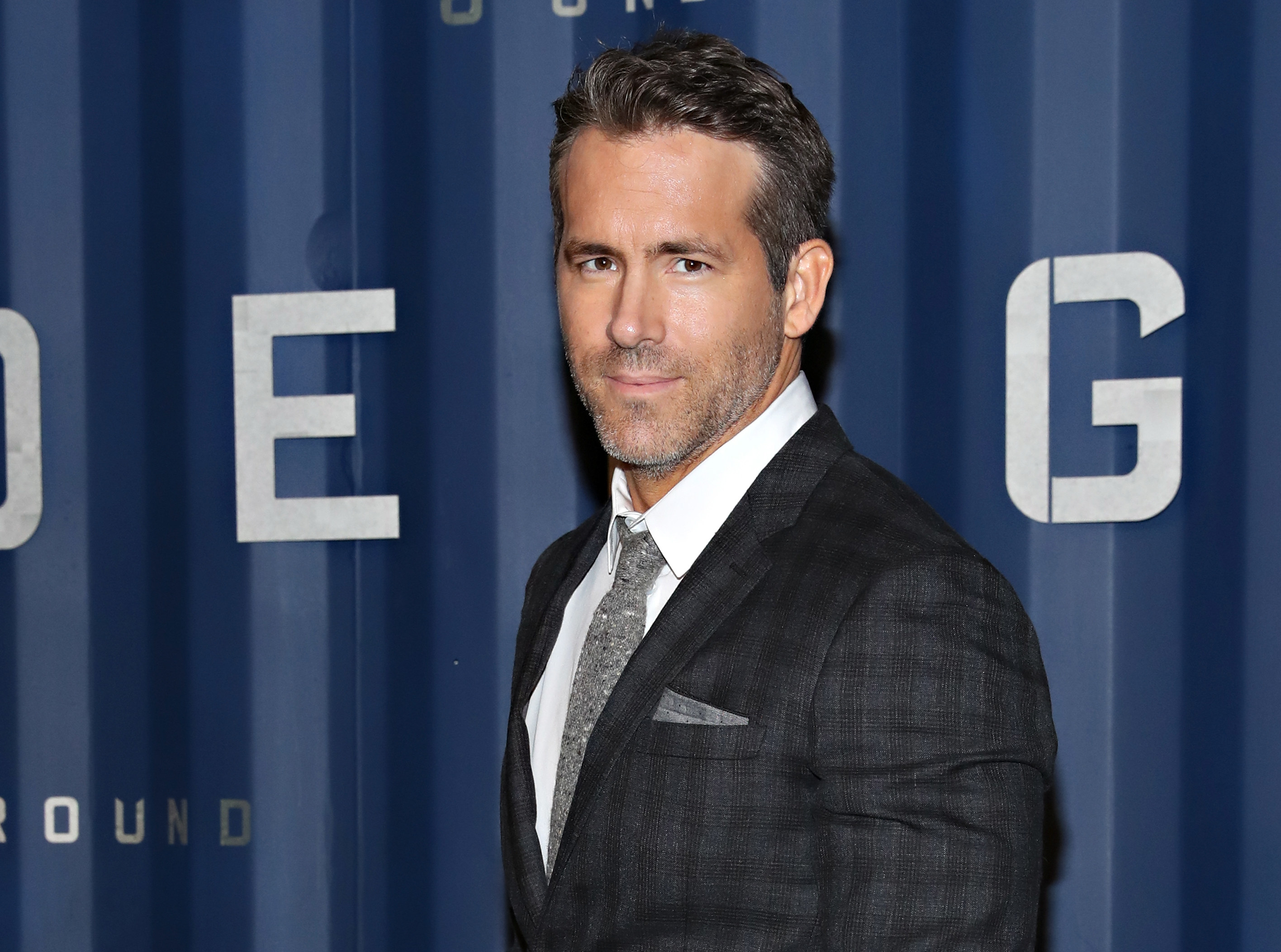 Ryan Reynolds in a suit and tie