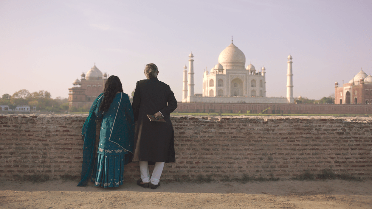 a couple from the show looking at the taj mahal