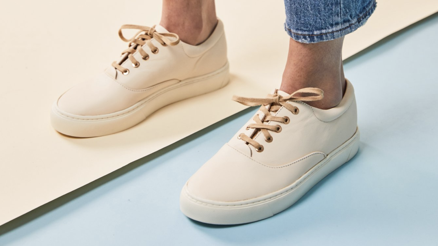 model wearing cream-colored sneakers from Nisolo