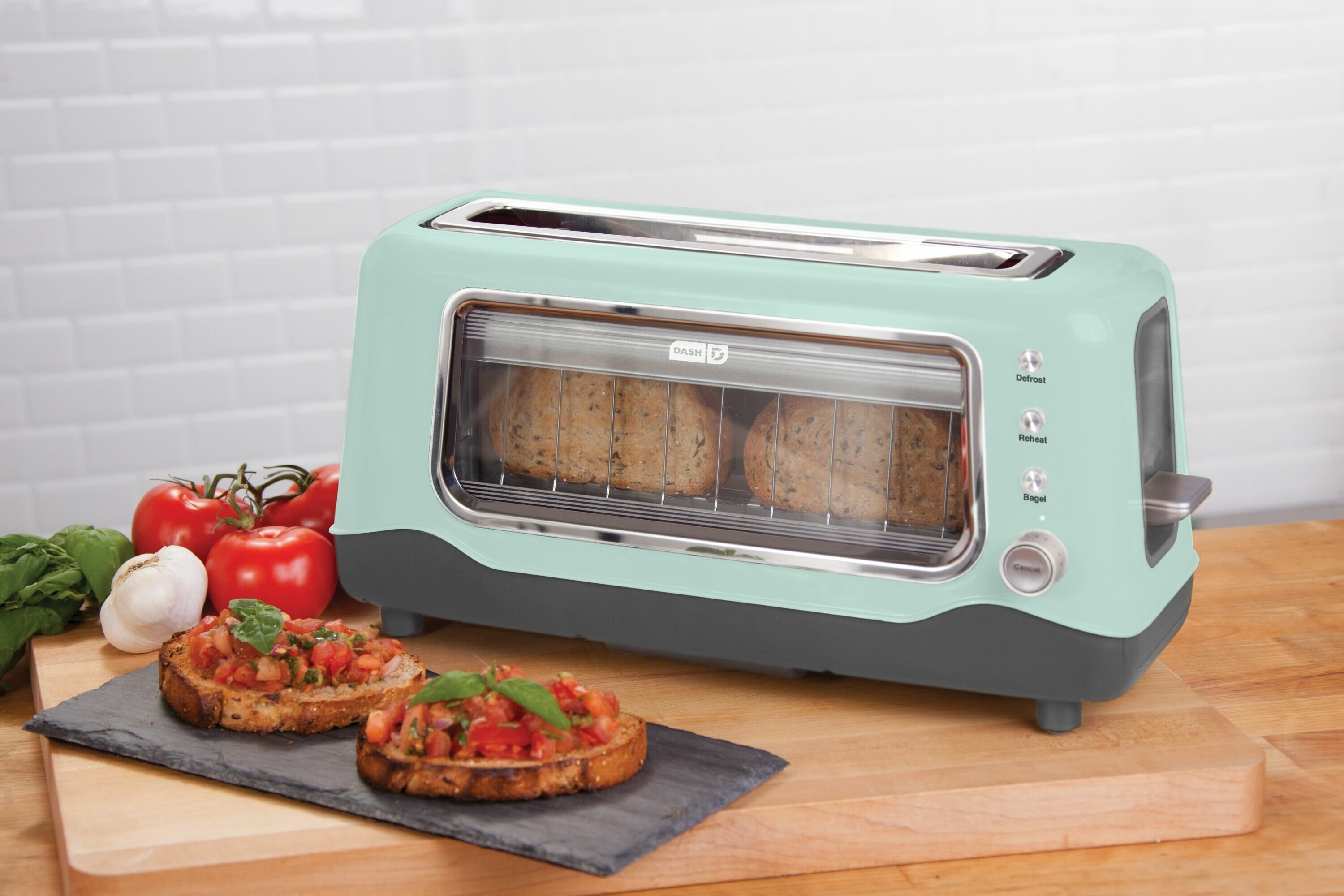 a light blue toaster with a window