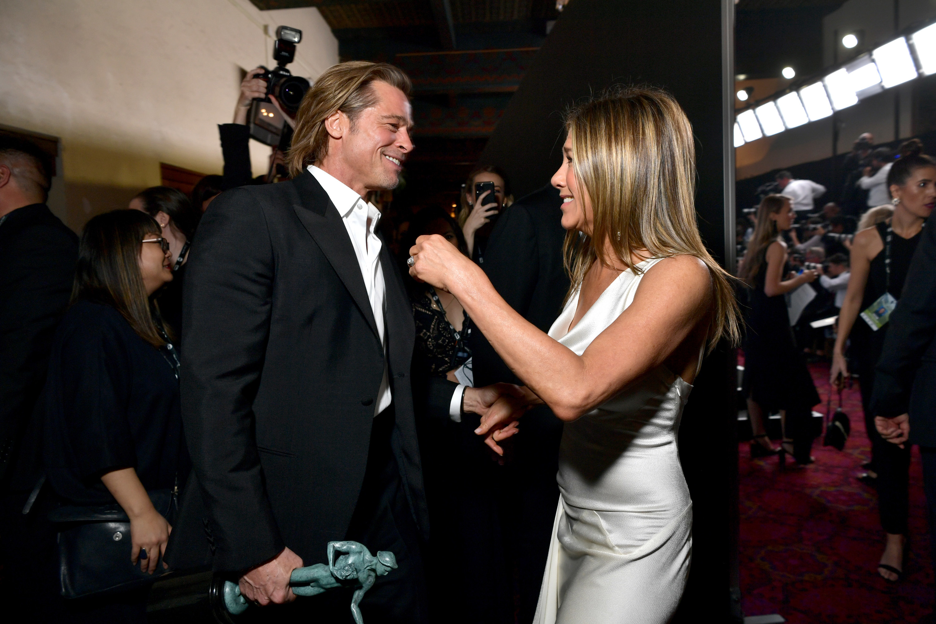 Brad and Jennifer greet each other at a recent event