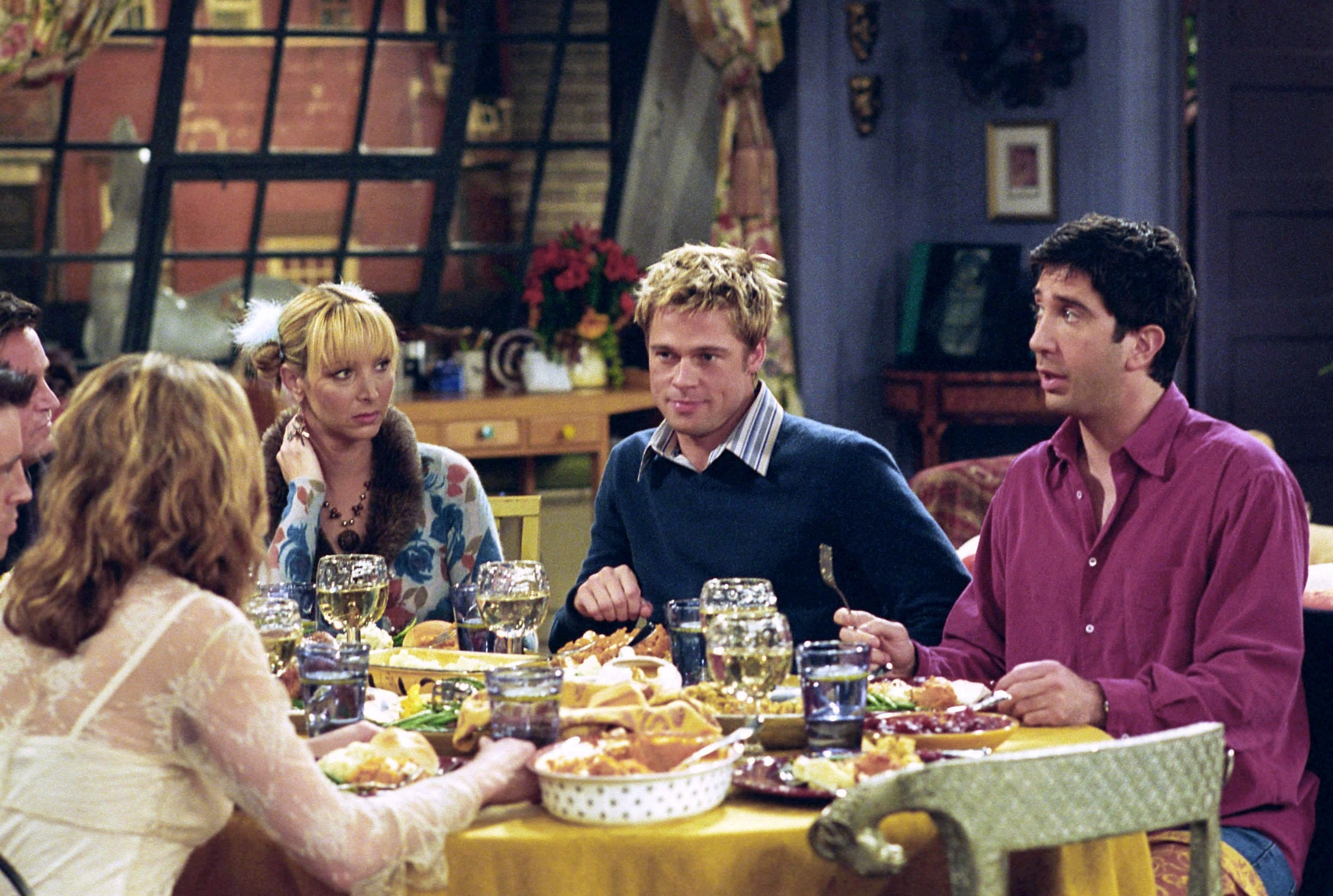 Brad sits at the table in the Friends apartment