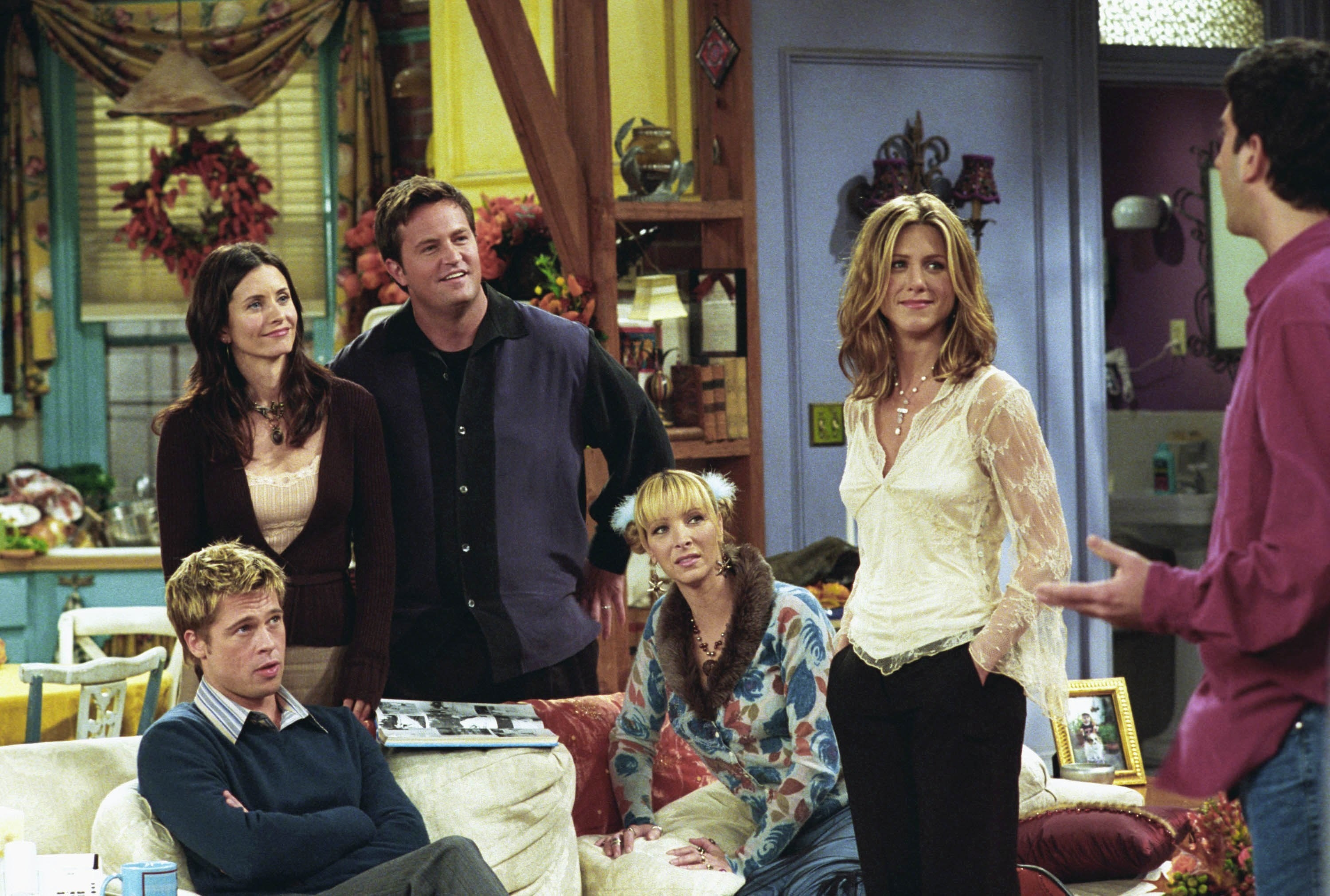 The Friends crew sits in the apartment with Brad
