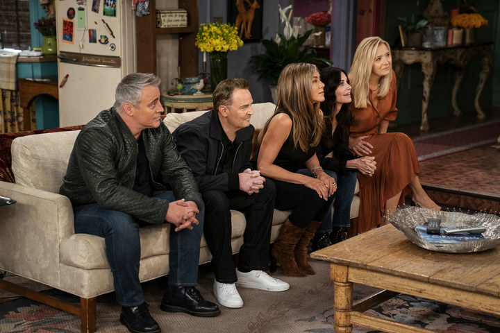 Present-day LeBlanc, Perry, Aniston, Cox, and Kudrow on the couch in the apartment set