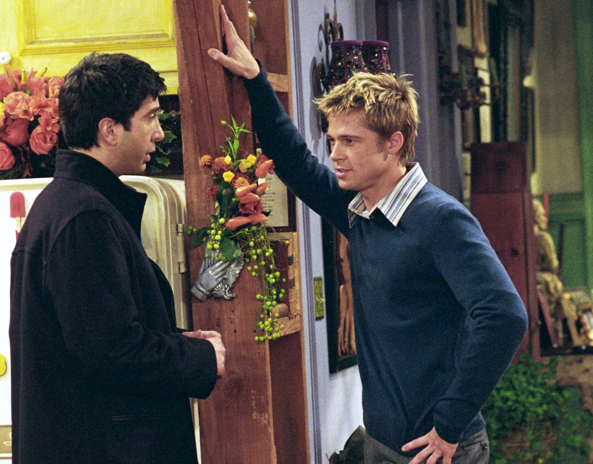 Brad's character and Ross chat during the episode