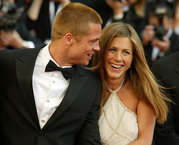 Brad and Jennifer embrace on a red carpet while still married