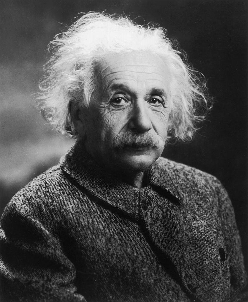 Albert Einstein posing for a photo