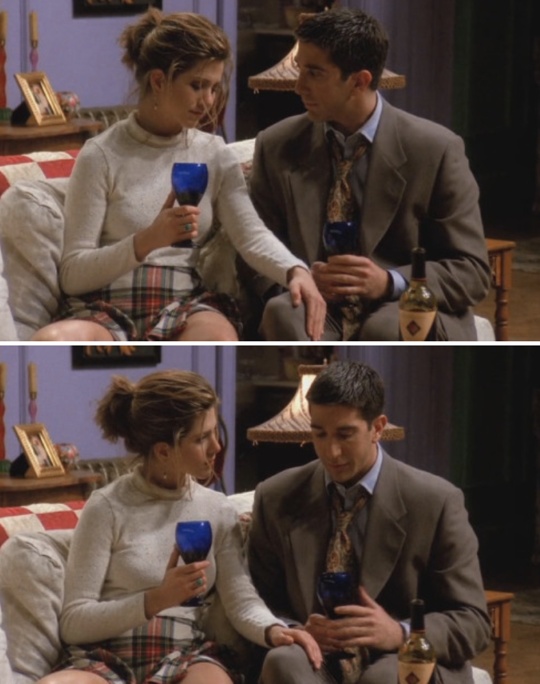 Ross and Rachel sitting on the couch drinking wine, Rachel touching his thigh