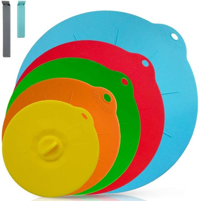 Yellow, orange, green, red, and light blue lid covers