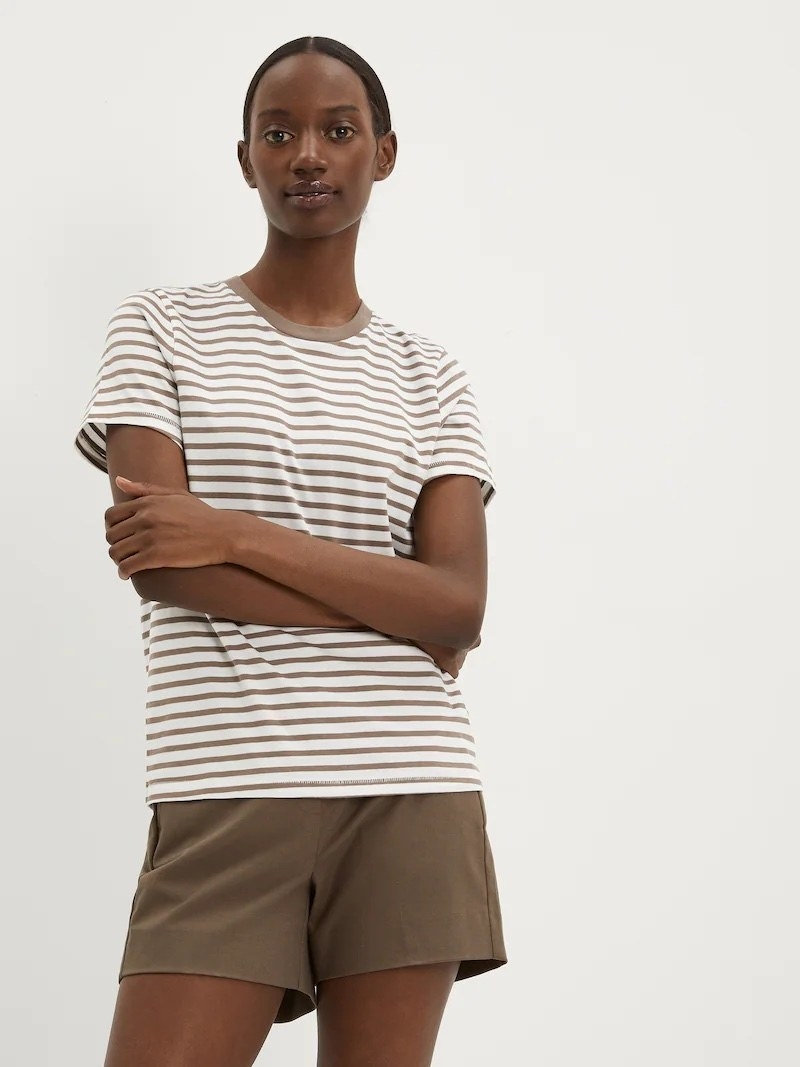 a model wearing the striped shirt