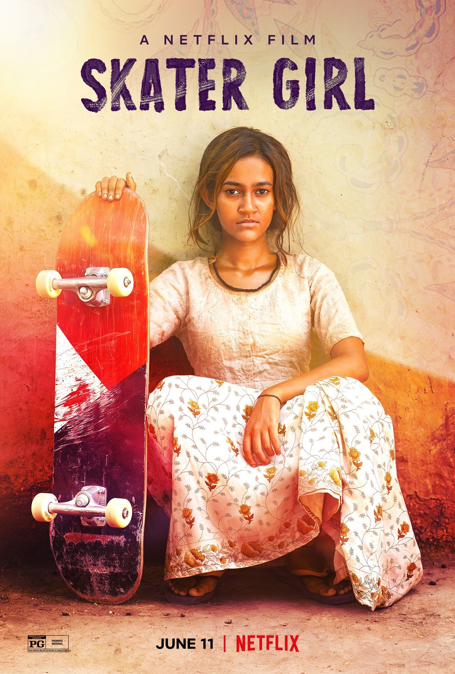 a girl sitting for a portrait while holding her skateboard