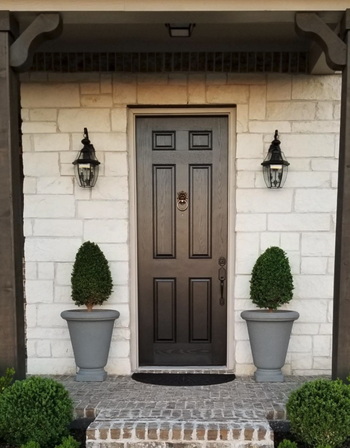 different reviewer image of front door with fresh black coat of paint