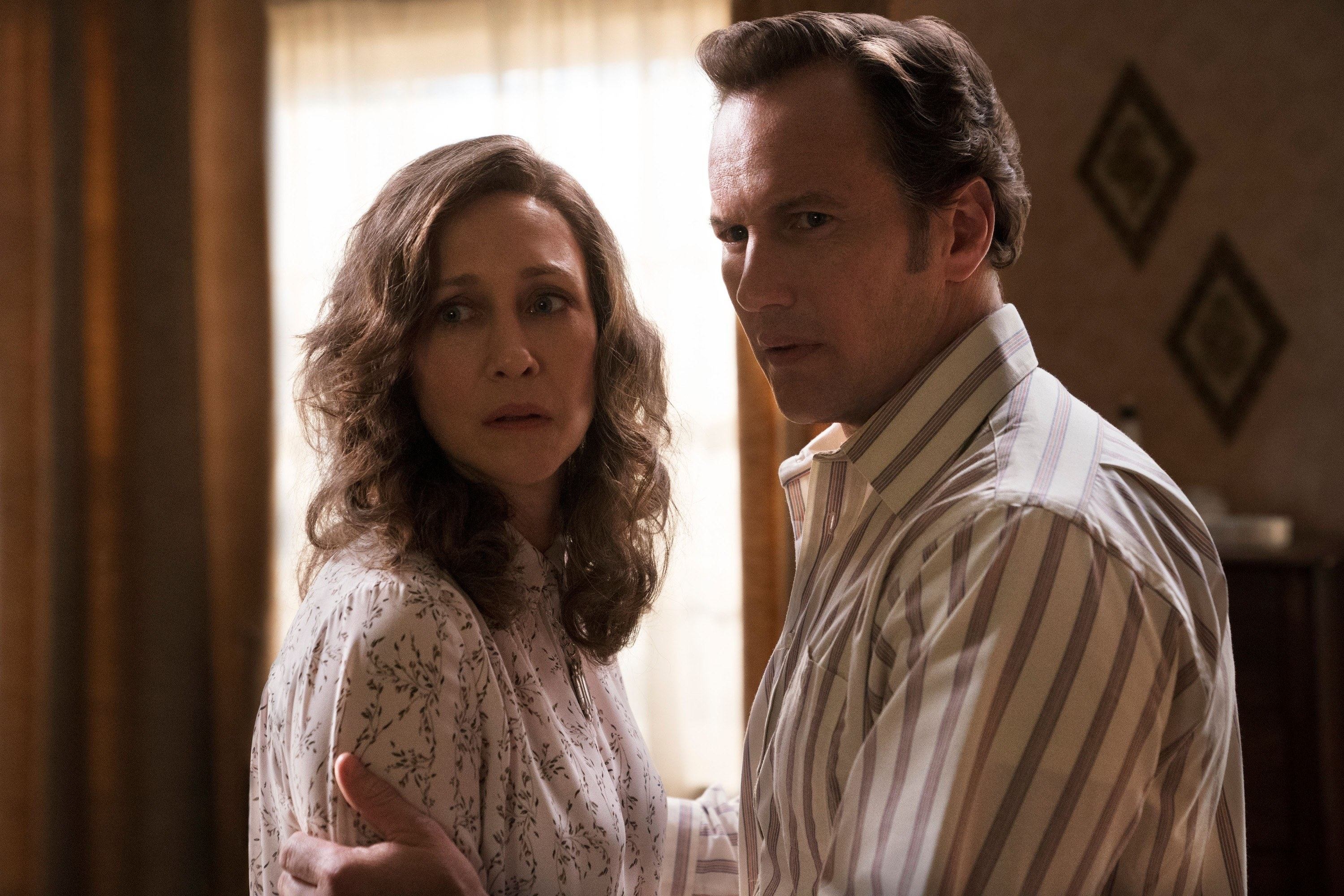 Vera Farmiga and Patrick Wilson as Lorraine and Ed Warren appearing to look scared and concerned