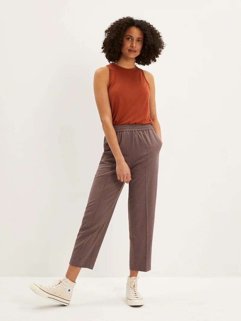 a model wearing the purple pants